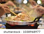 happy to eat pork and seafood...   Shutterstock . vector #1038968977