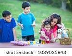 brothers coloring easter eggs | Shutterstock . vector #1039035643