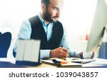 bearded young businessman... | Shutterstock . vector #1039043857