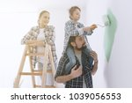 happy family renovating their... | Shutterstock . vector #1039056553