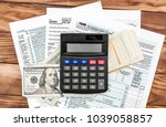 calculator with money on tax... | Shutterstock . vector #1039058857