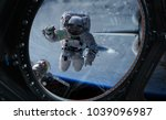 astronaut in space working on a ... | Shutterstock . vector #1039096987