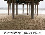 under a boardwalk | Shutterstock . vector #1039114303