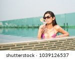 cheerful woman wearing purple... | Shutterstock . vector #1039126537