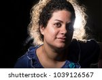 portrait of curly woman with... | Shutterstock . vector #1039126567