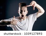 attractive young man with long... | Shutterstock . vector #1039127893