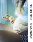 beautiful pregnant woman at home | Shutterstock . vector #1039131637