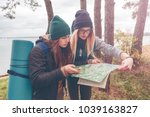 women travelers with the map | Shutterstock . vector #1039163827