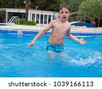 little boy having fun playing... | Shutterstock . vector #1039166113