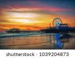 the santa monica pier at sunset ... | Shutterstock . vector #1039204873