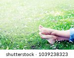 mother and baby feet in grass... | Shutterstock . vector #1039238323