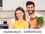Small photo of Handsome bearded man holding shopping bag with healthy, nutritious food, in pristine white shirt and slim woman, in yellow t-shirt