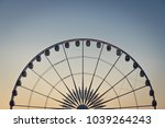 ferris wheel sunset  | Shutterstock . vector #1039264243