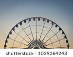 ferris wheel sunset  | Shutterstock . vector #1039264243