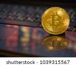 golden bitcoin on notebook... | Shutterstock . vector #1039315567