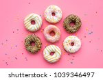 donuts decorated icing and... | Shutterstock . vector #1039346497