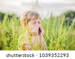 Boy Sneezes Because Of An...