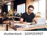 freelancer bearded man in t... | Shutterstock . vector #1039353907