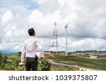 engineer overseeing the wind...   Shutterstock . vector #1039375807