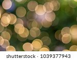 Small photo of Big circle orange bokeh with green color background.