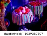 colorful candies in jars on... | Shutterstock . vector #1039387807