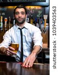 a male bartender pouring and... | Shutterstock . vector #1039403563