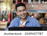 thumb up asian man working with ... | Shutterstock . vector #1039437787