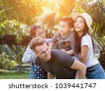 happy family hugging enjoying... | Shutterstock . vector #1039441747