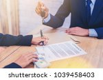 woman signing in contract for... | Shutterstock . vector #1039458403