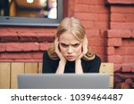 woman looking at laptop ... | Shutterstock . vector #1039464487