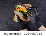 woman's hands in black rubber... | Shutterstock . vector #1039467763