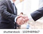 business people shaking hands ... | Shutterstock . vector #1039489867
