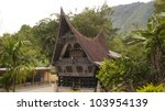 Batak house in Samosir Island, Lake Toba, North Sumatra, Indonesia. - stock photo