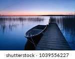 calm lake with reeds at sunrise ... | Shutterstock . vector #1039556227