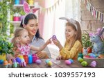 happy holiday  a mother and her ...   Shutterstock . vector #1039557193
