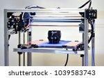 3d printer printing a model in... | Shutterstock . vector #1039583743
