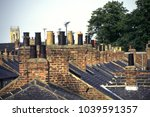 old victorian terraced house... | Shutterstock . vector #1039591357