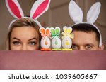 funny couple playing hunt eggs... | Shutterstock . vector #1039605667