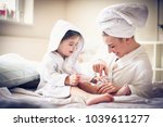 Small photo of Mother and daughter tae care of etch other.