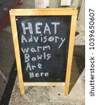 Small photo of Heat Advisory Warm Bowls Are Here Signboard