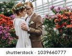 stylish young redhead wedding... | Shutterstock . vector #1039660777