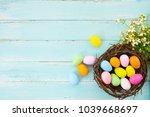 colorful easter eggs in nest...   Shutterstock . vector #1039668697