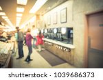 blurred motion customer at gas... | Shutterstock . vector #1039686373