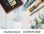 watercolors and paintbrushes on ... | Shutterstock . vector #1039691083