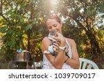 lovely woman holding baby cat.... | Shutterstock . vector #1039709017