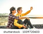 happy gay couple taking a... | Shutterstock . vector #1039720603