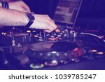dj mixes tracks at a party. dj... | Shutterstock . vector #1039785247