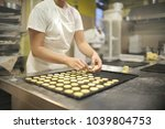 pastry chef working on her... | Shutterstock . vector #1039804753