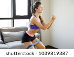 beautiful woman during her home ... | Shutterstock . vector #1039819387