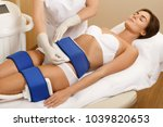 woman during cryolipolysis... | Shutterstock . vector #1039820653